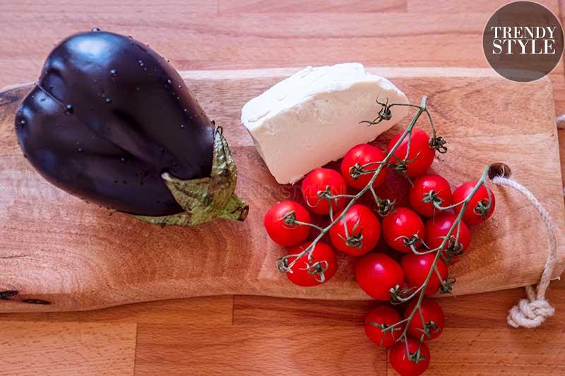 Pasta met aubergine, verse tomaten en gezouten ricotta. Foto: Charlotte Mesman